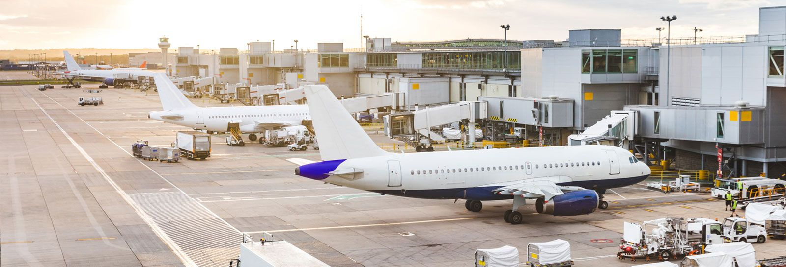 planes and service vehicles at airport banner image